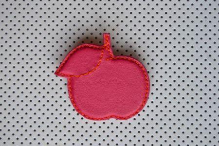 Broche pomme en cuir de chèvre, doublée cuir velours